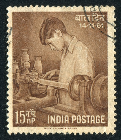 INDIA - CIRCA 1961: stamp printed by India, shows Boy Making Pottery, circa 1961