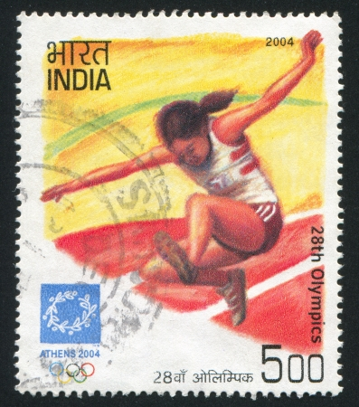 olympiad: INDIA - CIRCA 2004: stamp printed by India, shows long jump sportsman at Games of the XXVIII Olympiad, circa 2004