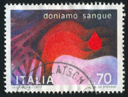 ITALY - CIRCA 1977: stamp printed by Italy, shows Symblic blood donation, circa 1977