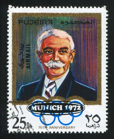 FUJEIRA - CIRCA 1972: stamp printed by Fujeira, shows Pierre de Coubertin, circa 1972 Stock Photo - 15438224