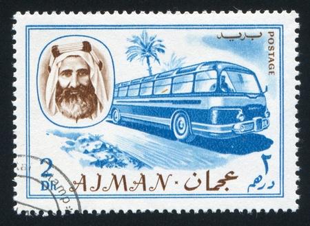 sheik: AJMAN - CIRCA 1964: stamp printed by Ajman, shows Sheik Rashid bin Humaid al Naimi and bus, circa 1964