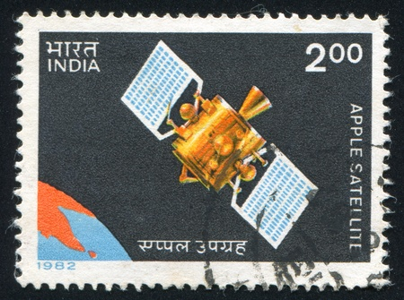 orbital spacecraft: INDIA - CIRCA 1982: stamp printed by India, shows satellite, circa 1982