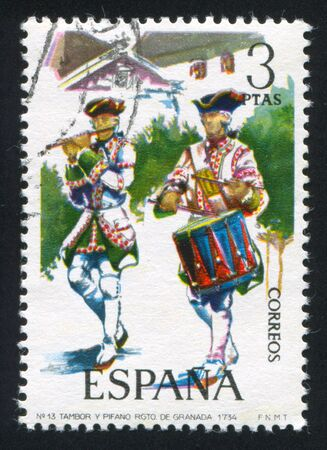 SPAIN - CIRCA 1974: stamp printed by Spain, shows Piper and drummer, Granada Regiment, 1734, circa 1974. Stock Photo - 15508919