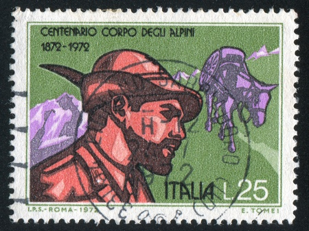 cavalryman: ITALY-CIRCA 1972: stamp printed by Italy, shows Alpine Soldier and Pack Mule, circa 1972 Editorial