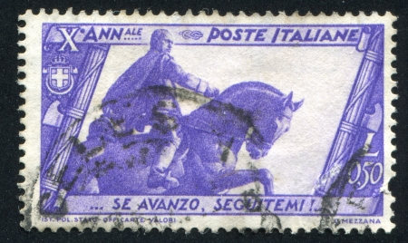 ITALY - CIRCA 1932: stamp printed by Italy, shows Mussolini statue in Bologna, circa 1932 Stock Photo - 15619439