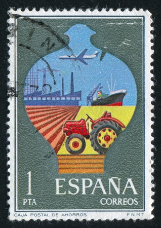 SPAIN - CIRCA 1976: stamp printed by Spain, shows Postal Savings Box with Symbols, circa 1976