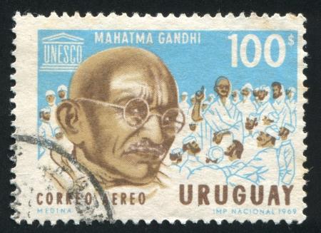 mahatma: URUGUAY - CIRCA 1969: stamp printed by Uruguay, shows Mahatma Gandhi and UNESCO Emblem, circa 1969