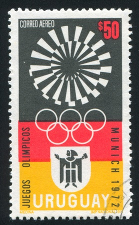 olympic symbol: URUGUAY - CIRCA 1971: stamp printed by Uruguay, shows Munich Olympic Games Emblem, circa 1971