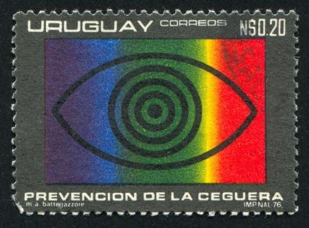 URUGUAY - CIRCA 1976: stamp printed by Uruguay, shows Eye and Spectrum, circa 1976 Stock Photo - 15619460