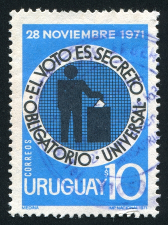 voter: URUGUAY - CIRCA 1971: stamp printed by Uruguay, shows Voter Casting Ballot, circa 1971
