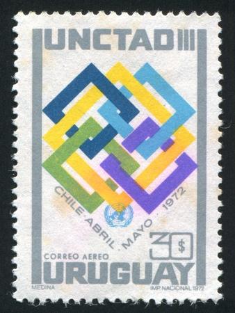 un: URUGUAY - CIRCA 1972: stamp printed by Uruguay, shows Interlocking Squares and UN Emblem, circa 1972