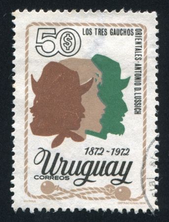 URUGUAY - CIRCA 1974: stamp printed by Uruguay, shows Three Gauchos, circa 1974 Stock Photo - 15619469