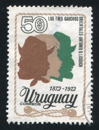 URUGUAY - CIRCA 1974: stamp printed by Uruguay, shows Three Gauchos, circa 1974 Stock Photo - 15619469