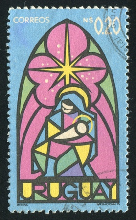 son of god: URUGUAY - CIRCA 1975: stamp printed by Uruguay, shows Virgin and Child, circa 1975 Editorial