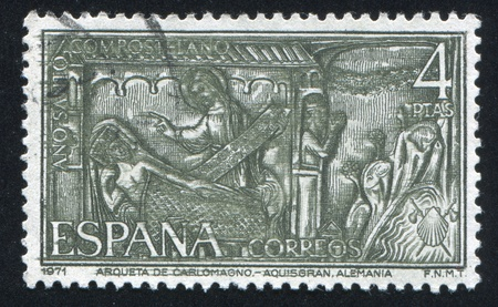 catholicity: SPAIN - CIRCA 1971: stamp printed by Spain, shows Woman, holy man and supplicant, circa 1971 Editorial