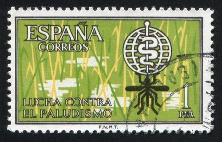 SPAIN - CIRCA 1962: stamp printed by Spain, shows Malaria eradication emblem, circa 1962 Stock Photo - 15671327