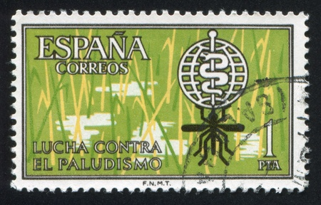 SPAIN - CIRCA 1962: stamp printed by Spain, shows Malaria eradication emblem, circa 1962 Stock Photo - 15671327