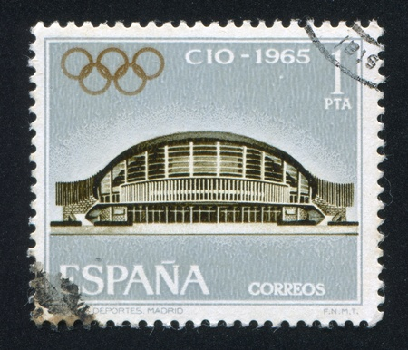 olympic symbol: SPAIN - CIRCA 1965: stamp printed by Spain, shows Sports Palace in Madrid, circa 1965