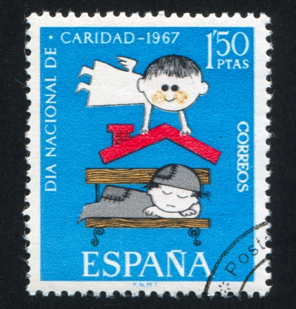 SPAIN - CIRCA 1967: stamp printed by Spain, shows Guardian Angel over Indigent sleeper, circa 1967 Stock Photo - 15671349