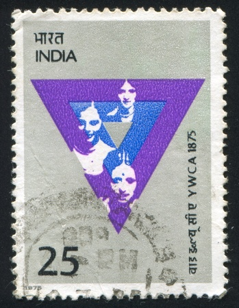 INDIA - CIRCA 1975: stamp printed by India, shows Women and emblem, circa 1975