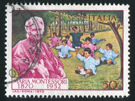 ITALY - CIRCA 1970: stamp printed by Italy, shows Doctor Maria Montessori and children, circa 1970