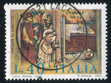ITALY - CIRCA 1974: stamp printed by Italy, shows Saint Francis adoring Christ child, circa 1974