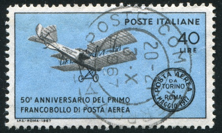 ITALY - CIRCA 1967: stamp printed by Italy, shows Pomilio PC-1 Biplane, and airmail postmark, circa 1967 Stock Photo - 15740832