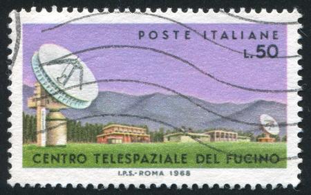 speculum: ITALY - CIRCA 1968: stamp printed by Italy, shows Parabolic antenan in Fucino, circa 1968 Editorial