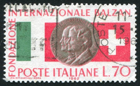 ITALY - CIRCA 1962: stamp printed by Italy, shows Swiss and Italian flags and Eugenio and Angelo Lina Balzan medal, circa 1962 Stock Photo - 15740837