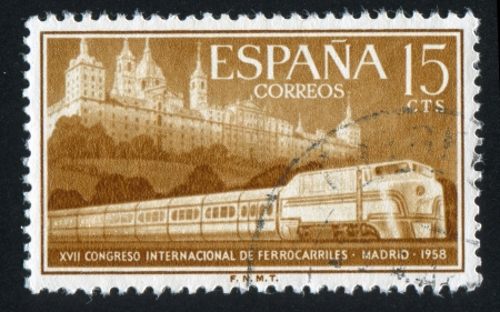 streamlined: SPAIN - CIRCA 1958: stamp printed by Spain, shows Escorial and Streamlined Train, circa 1958