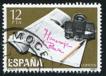 SPAIN - CIRCA 1981: stamp printed by Spain, shows Newspaper and Camera, circa 1981