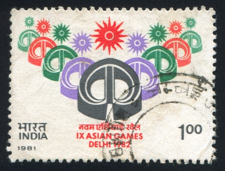 INDIA - CIRCA 1981: stamp printed by India, shows Asian Games, New Delhi emblem, circa 1981 Stock Photo - 15849897