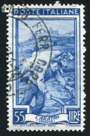 sulcus: ITALY - CIRCA 1950: stamp printed by Italy, shows Plowing, circa 1950
