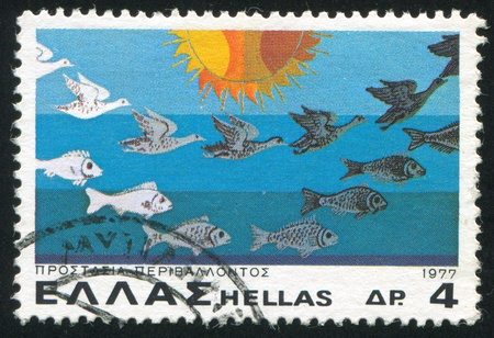 GREECE - CIRCA 1977: stamp printed by Greece, shows Fish and Birds Suffering from Pollution, circa 1977 Stock Photo - 15944573