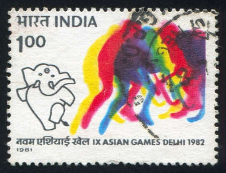 INDIA - CIRCA 1981: stamp printed by India, shows Mascot elephant and Field Hockey team, circa 1981 Stock Photo - 15944548