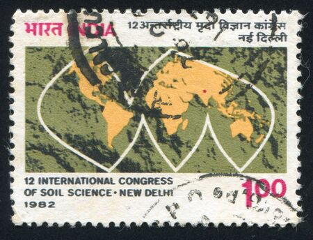 INDIA - CIRCA 1982: stamp printed by India, shows stylized map with continents, circa 1982 Stock Photo - 15944606