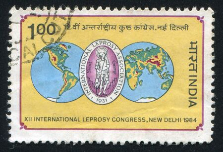 INDIA - CIRCA 1984: stamp printed by India, shows map of the globe and emblem, circa 1984 Stock Photo - 15944659