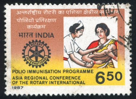 asterix: INDIA - CIRCA 1987: stamp printed by India, shows mother with baby and nurse, asterix symbol, circa 1987