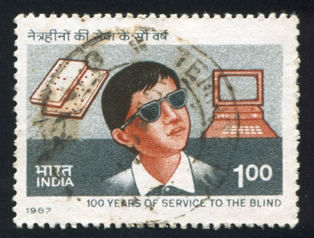 INDIA - CIRCA 1987: stamp printed by India, shows blind boy, computer, book, circa 1987 Stock Photo - 15944703