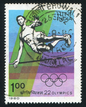 olympiad: INDIA - CIRCA 1980: stamp printed by India, shows High Jump sportsman at the Olympiad, circa 1980