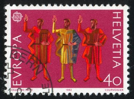 SWITZERLAND - CIRCA 1982: stamp printed by Switzerland, shows Three Men, circa 1982