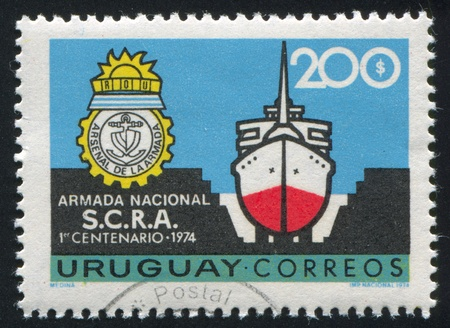 URUGUAY - CIRCA 1974: stamp printed by Uruguay, shows Ship in Dry Dock, Arsenal's Emblem, circa 1974