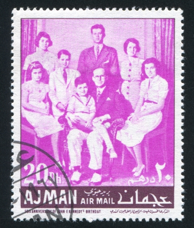 AJMAN - CIRCA 1971: stamp printed by Ajman, shows John Kennedy and his Family, circa 1971 Stock Photo - 16223962