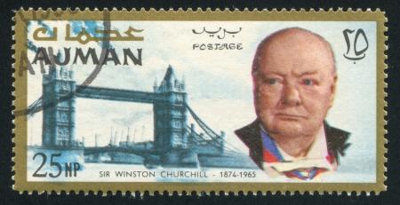 AJMAN - CIRCA 1976: stamp printed by Ajman, shows Winston Churchill and Tower Bridge, circa 1976 Stock Photo - 16223841