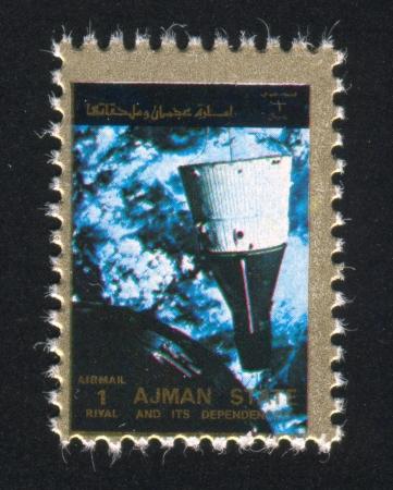 ajman: AJMAN - CIRCA 1976: stamp printed by Ajman, shows a Spaceship, circa 1976