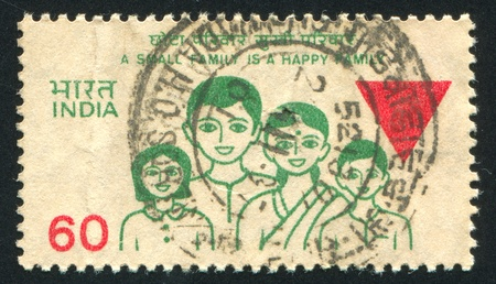 INDIA - CIRCA 1987: stamp printed by India, shows family, circa 1987 Stock Photo - 16223805