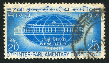 INDIA - CIRCA 1969: stamp printed by India, shows Globe and Parliament, circa 1969 Stock Photo - 16223836