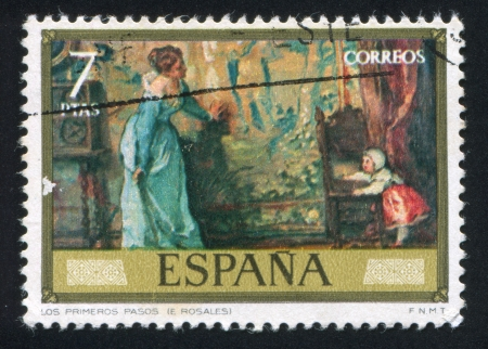 SPAIN - CIRCA 1974: stamp printed by Spain, shows The first steps (Eduardo Rosales), circa 1974 Stock Photo - 16223813
