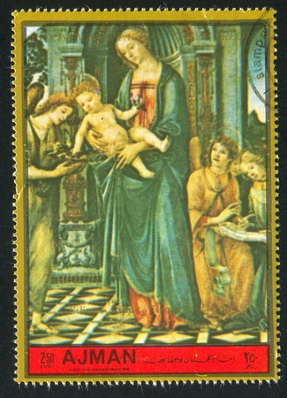 AJMAN - CIRCA 1976: stamp printed by Ajman, shows Madonna and Child, circa 1976
