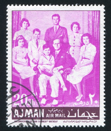 AJMAN - CIRCA 1971: stamp printed by Ajman, shows John Kennedy and his Family, circa 1971 Stock Photo - 16285491